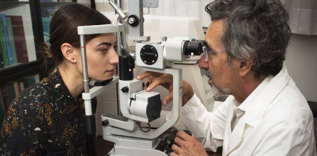 Eye doctor in Padua performs slit-lamp exam